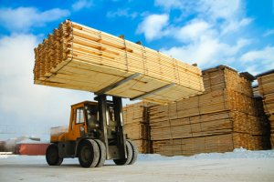 lumber being loaded by a forklift