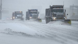 snow plows clearing a highway